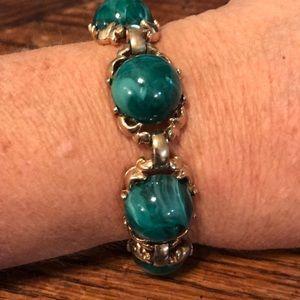 "7"" long VTG bracelet with green cabochons"